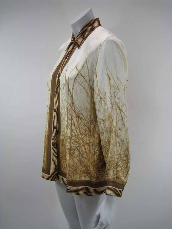 Amazing silk tiger in the wild motif print Escada blouse.  Button up with fold over collar.  Huge stunning face of a tiger on back of blouse and all over wheat print.  Hip length.  100% silk.  Tagged a size 38.  This is in excellent pre-owned