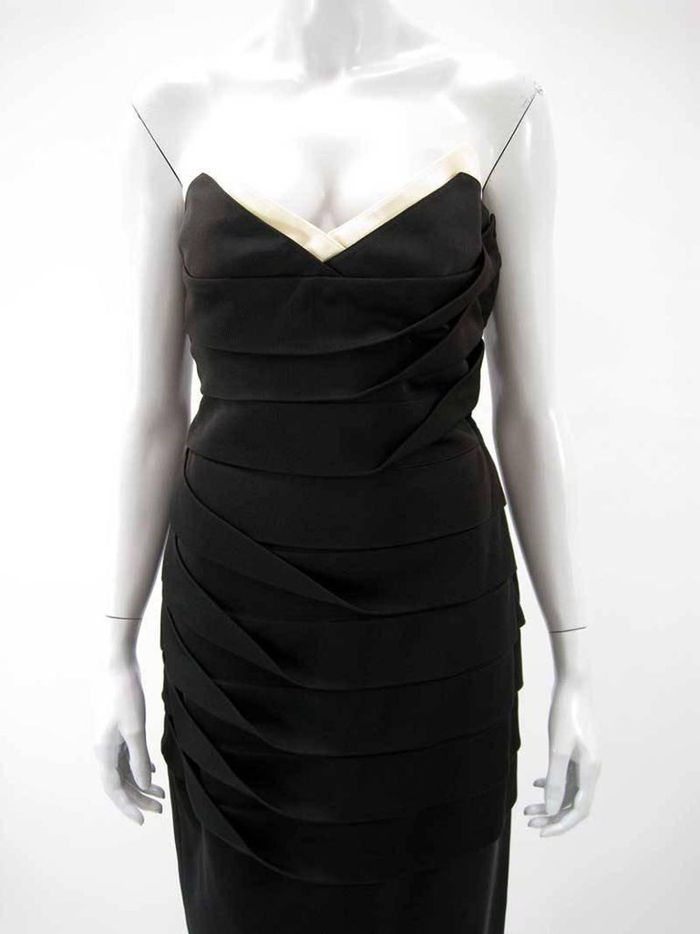 Fabulous vintage Gianni Versace black strapless dress.  Fold over collar in off white.  Heavier stretch jersey.  Folded tiers through the bodice make up the form fitting shape.  Side zipper.   Fabric is acetate, silk, cotton and nylon blend  Tagged
