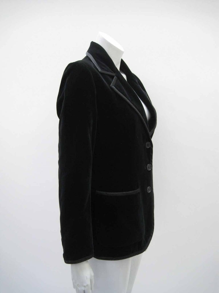 Sumptuous YSL Rive Gauche black velvet blazer.  Soft silk velvet with silk piping.  Fitted shape hits at hip.  Three button closure with three button wrist detail.  One chest pocket and two front patch pockets.  Fully lined.  Tagged size 10.  This