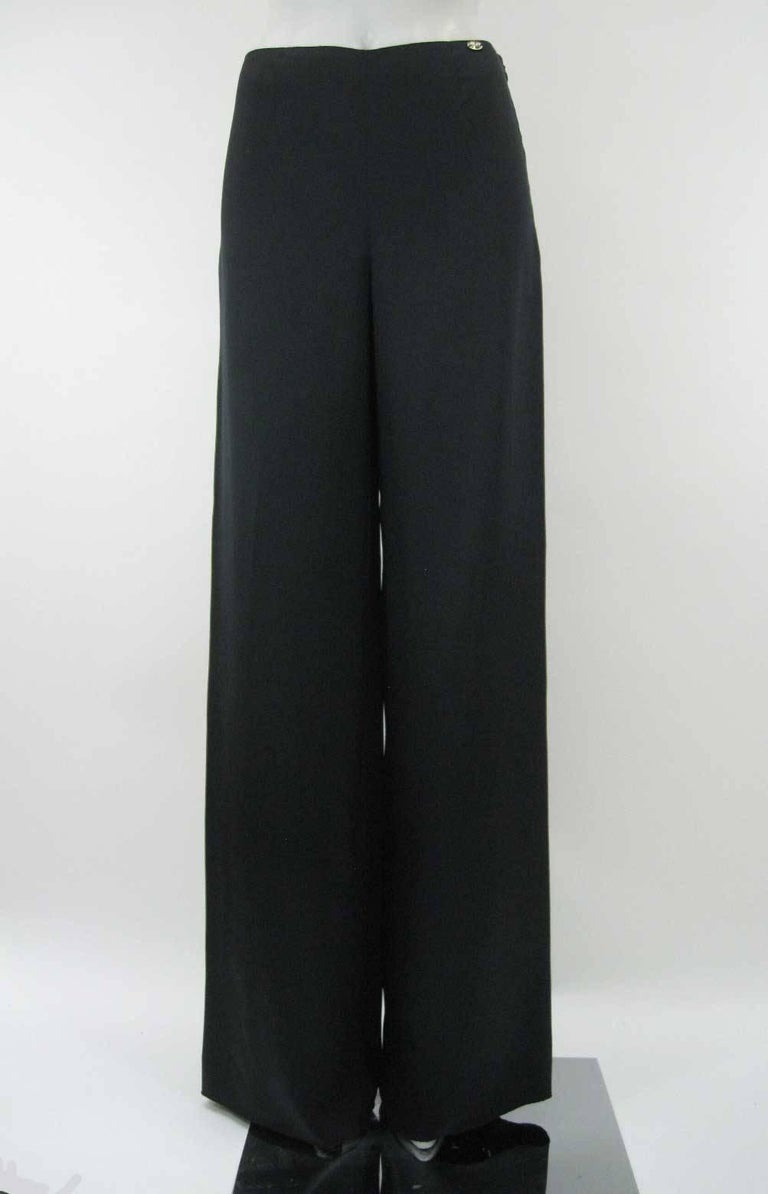 Elegant and classic black Chanel palazzo pants.  Luxurious silk satin fabric.  Mid rise with hidden side zipper.  Front and back darting.  Chanel name plate on left hip.  Fully lined.  Tagged a size 36.  This is in excellent pre-owned condition with