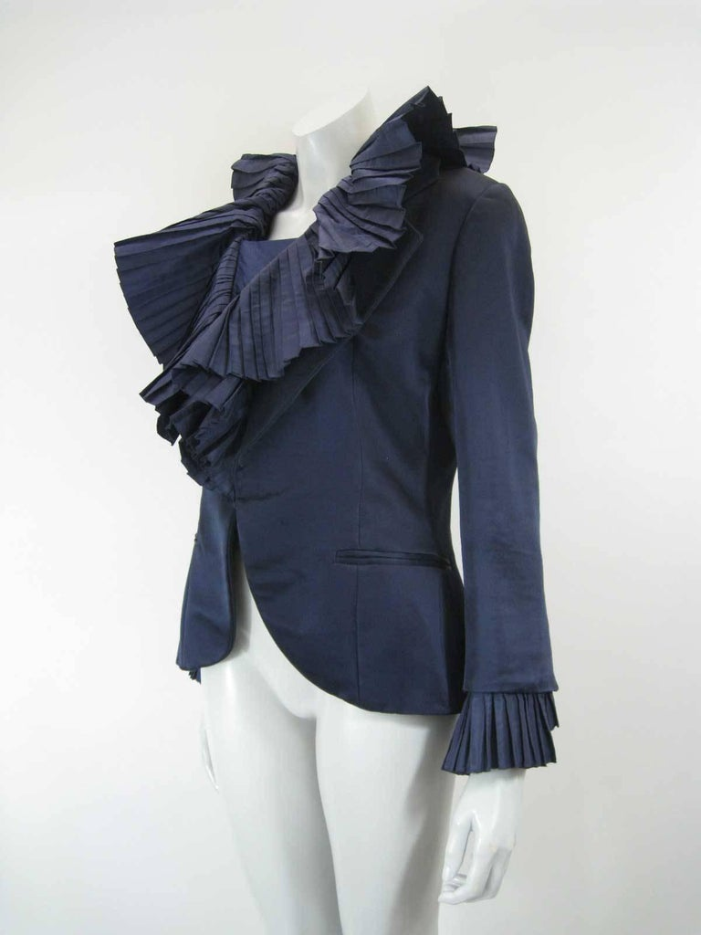 Stunning vintage Christian Dior Boutique evening jacket.  Deep blue satin color.   Exaggerated accordian pleated collar and cuffs.  Hidden snap closure.  Hidden button placket.  Faux pockets on front hip.  Button cuffs.  Numbered 45148. Handwritten