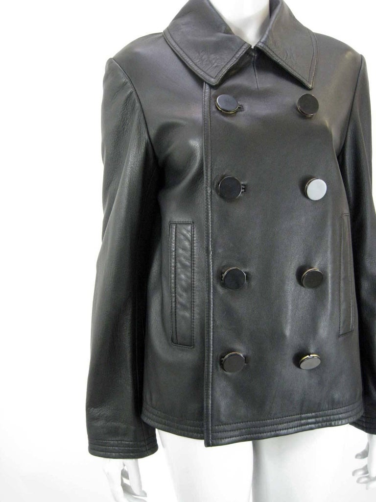 Balenciaga classic black leather jacket.  Soft buttery leather.  Double breasted with black & gold disk buttons.   Front slit pockets.  Fully lined.  Back slit.  Tagged size 40.  This is in excellent pre-owned condition with no holes, stains or