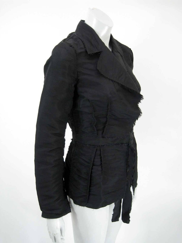 2005 Lanvin black silk wrap jacket.  Textured, ruched and pintucked silk.  Frayed hems.  Hook and eye closure and frayed self tie at waist.  Tagged size 38.  Fabric is silk.  This is in excellent pre-owned condition with no holes, stains or