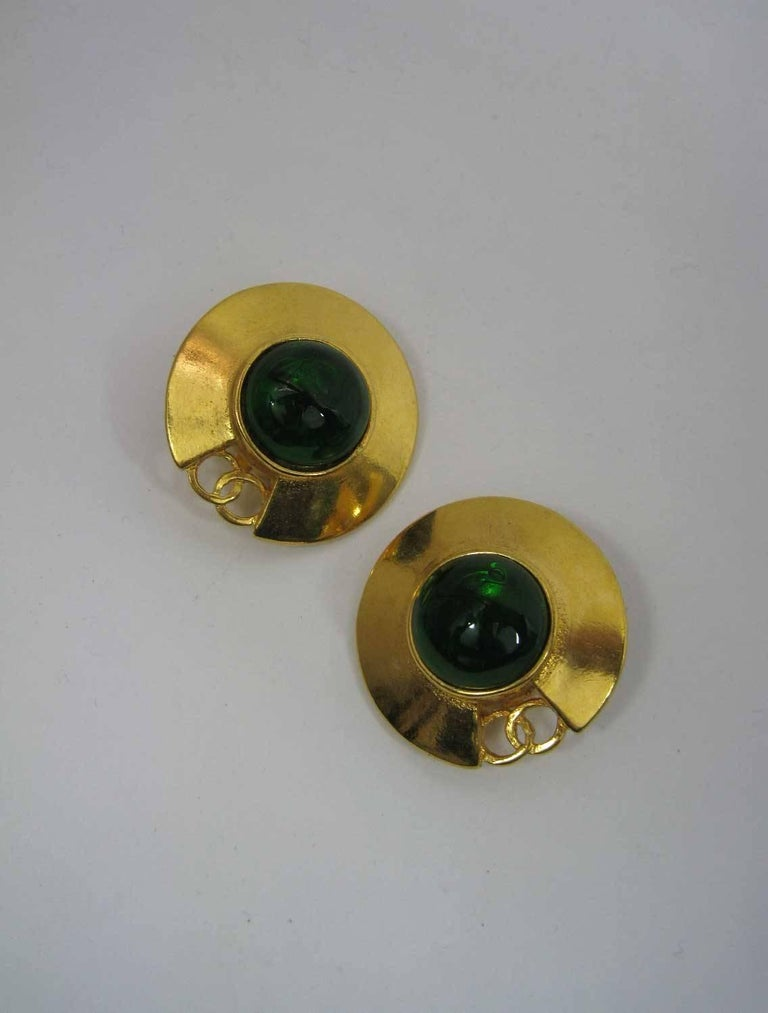1980's Chanel gold-tone saucer shaped earrings.  CC design with large green glass