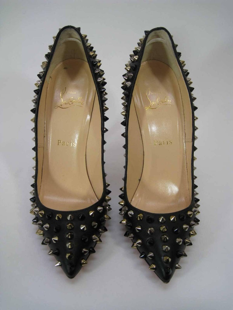 Iconic Louboutin studded high heels.  Style is Pigalle Spikes.  In original box with extra heel caps & spikes included.  Marked size 37.5.  Heel is 5