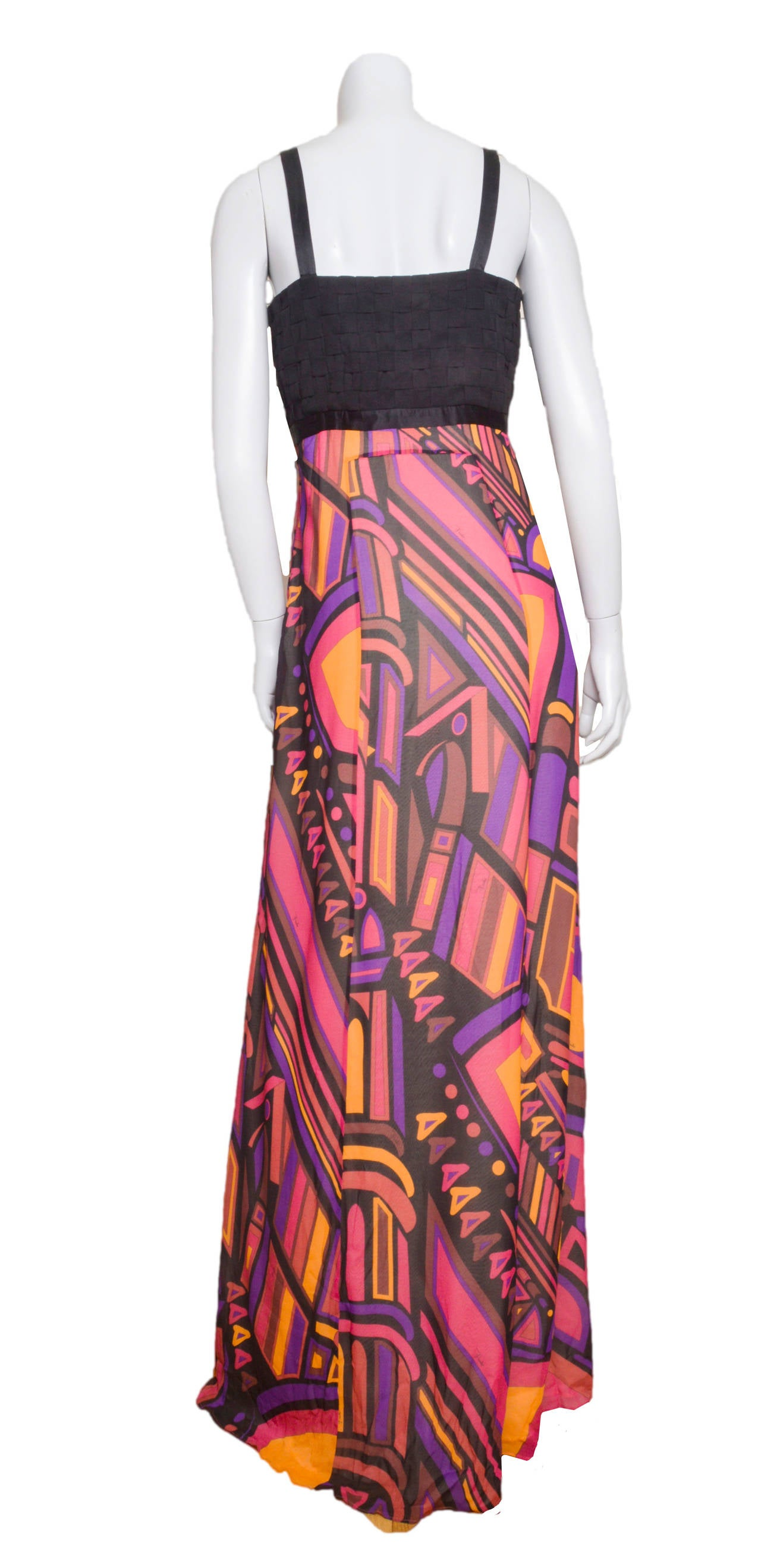 Stunning empire waist silk crepe Emilio Pucci dress. Plunging neckline with empire waist and basket weave bodice. Jewel tone abstract print a-line skirt. Skirt is lined. Side zip with hook an eye closure. Tagged a size 40.