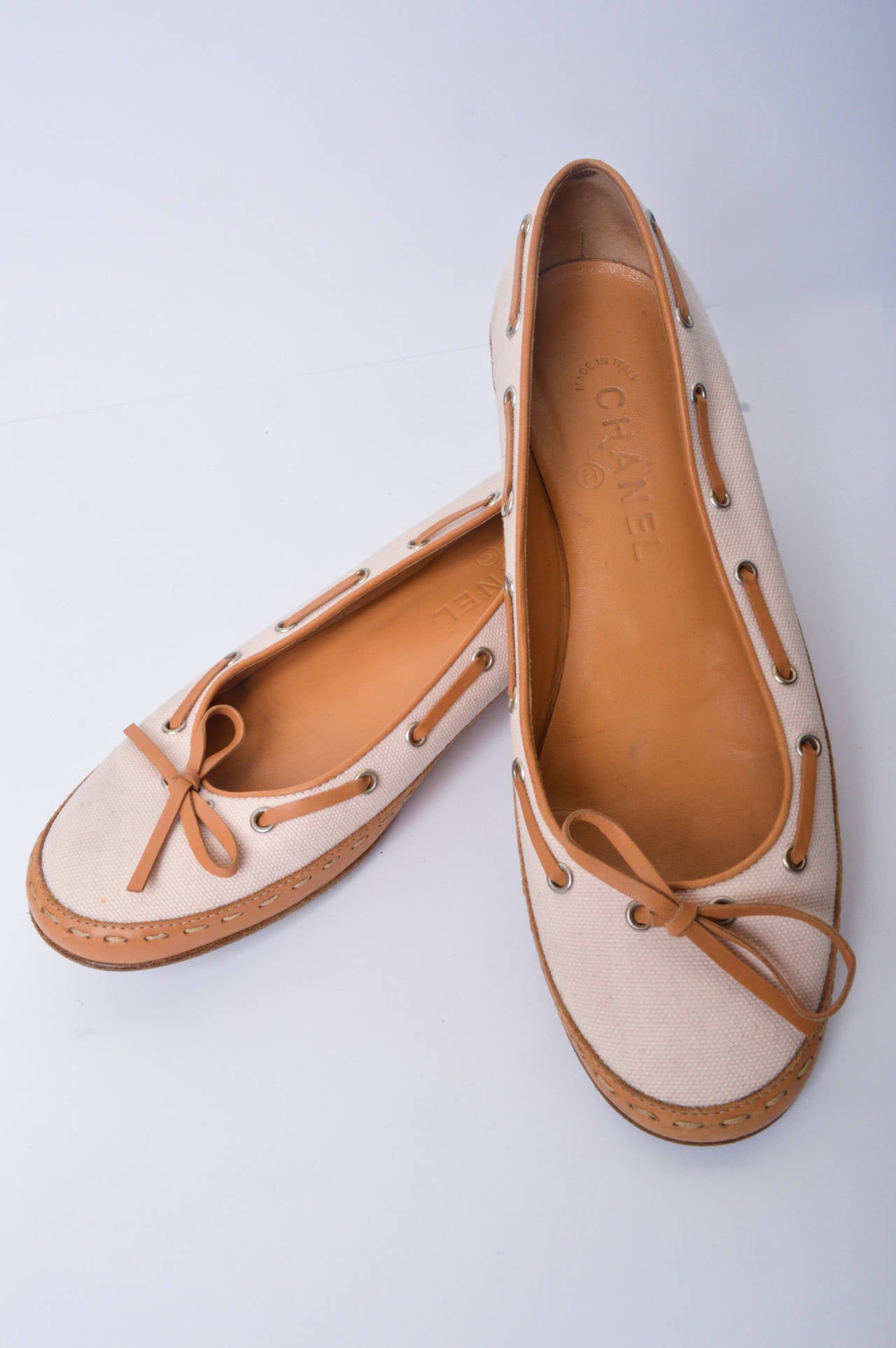 Chanel canvas and leather ballerina flats. Very pale pink canvas uppers with tan leather lacing. Leather trim and leather soles. Marked size 37.