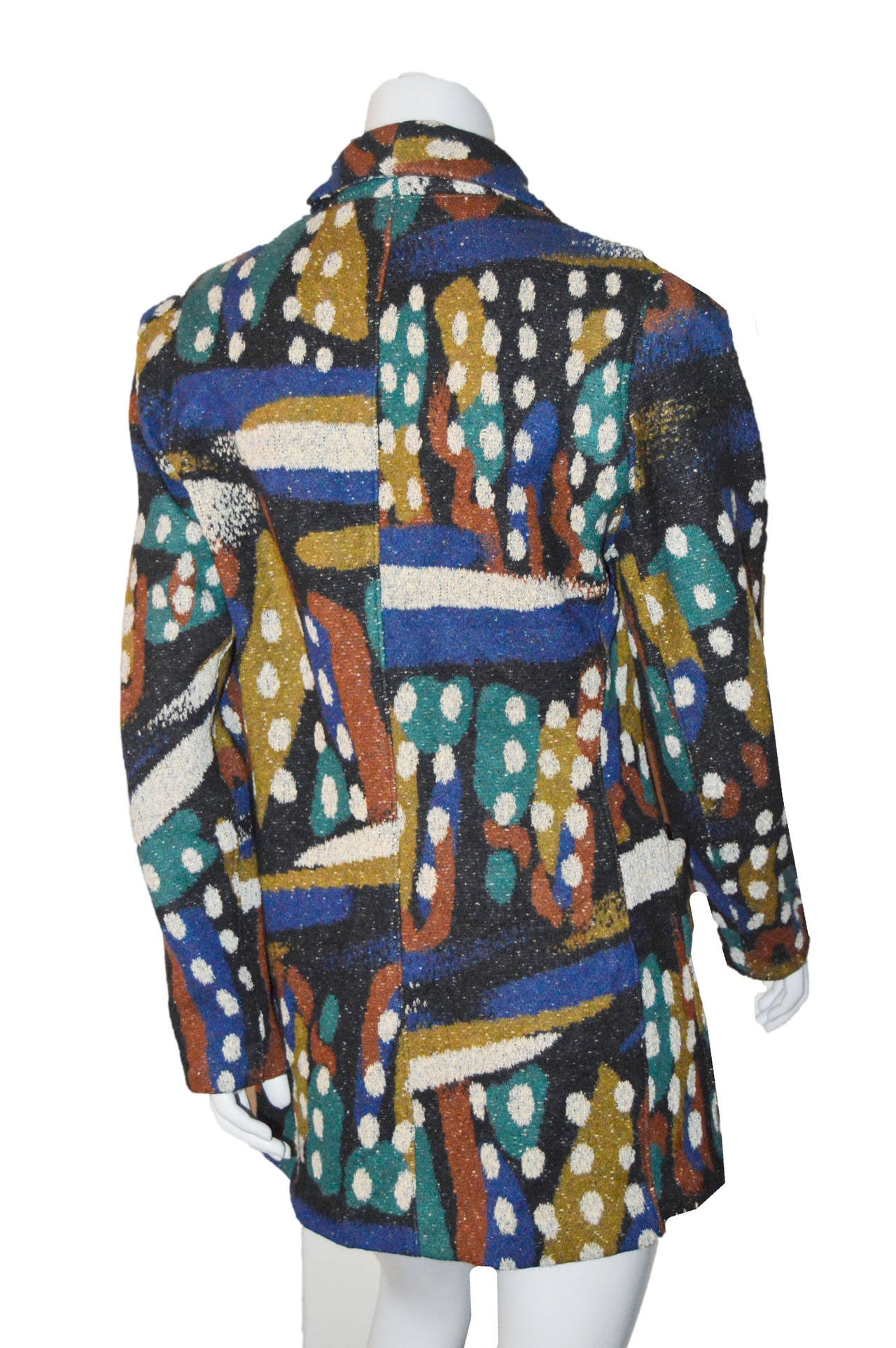 Vintage Missoni coat in a rich Autumn color palette.  Slightly fitted shape with wood buttons. Lightly padded shoulders for shape. Large front pockets. Unlined.