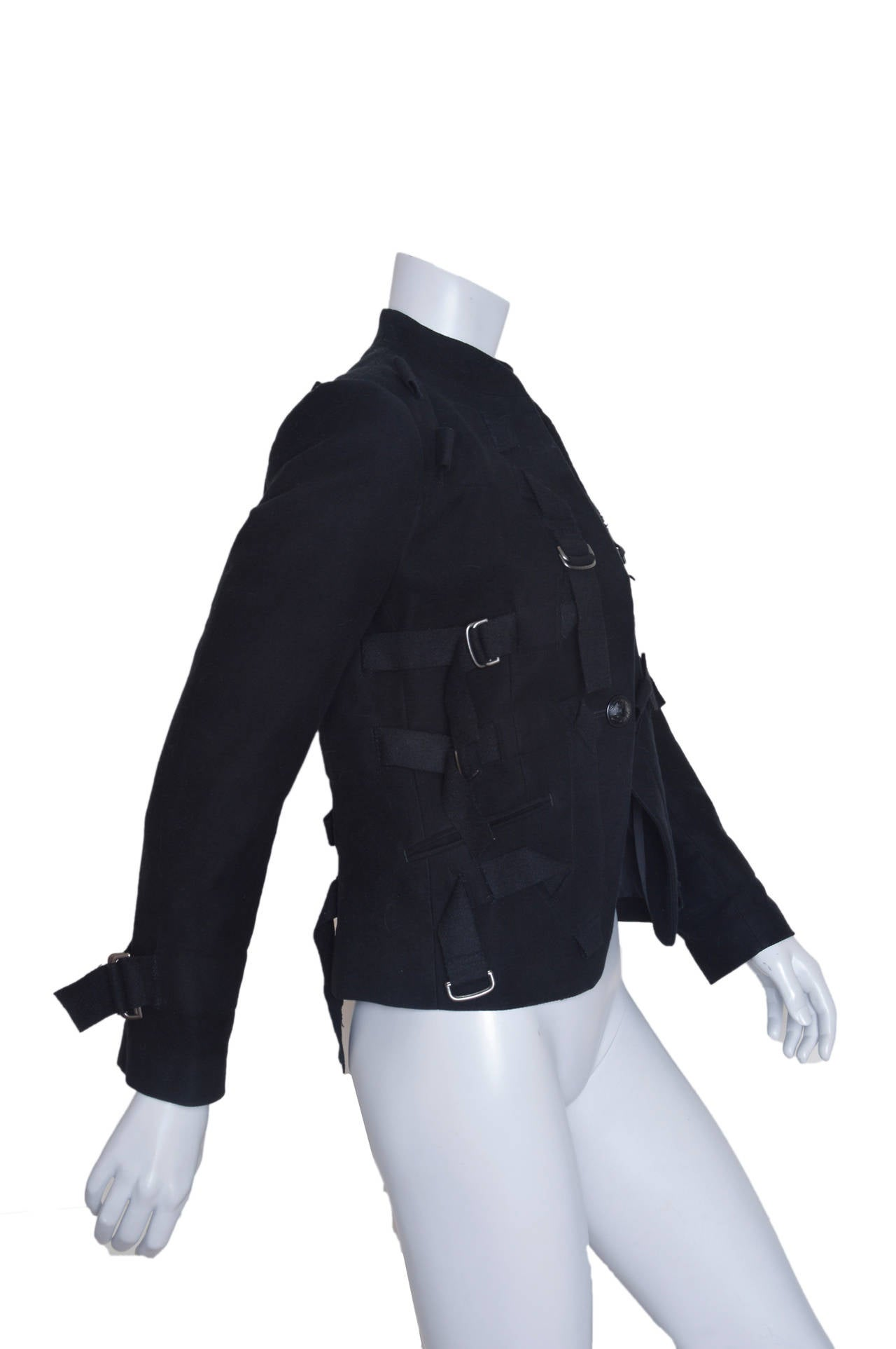 Crazy amazing Issey Miyake wool jacket. Slightly militaristic/slighty avant garde = totally inventive. Twisted and looped cotton straps and pewter adjustable buckles adorn the front, side and back. Adjustable straps at wrists. Embellished