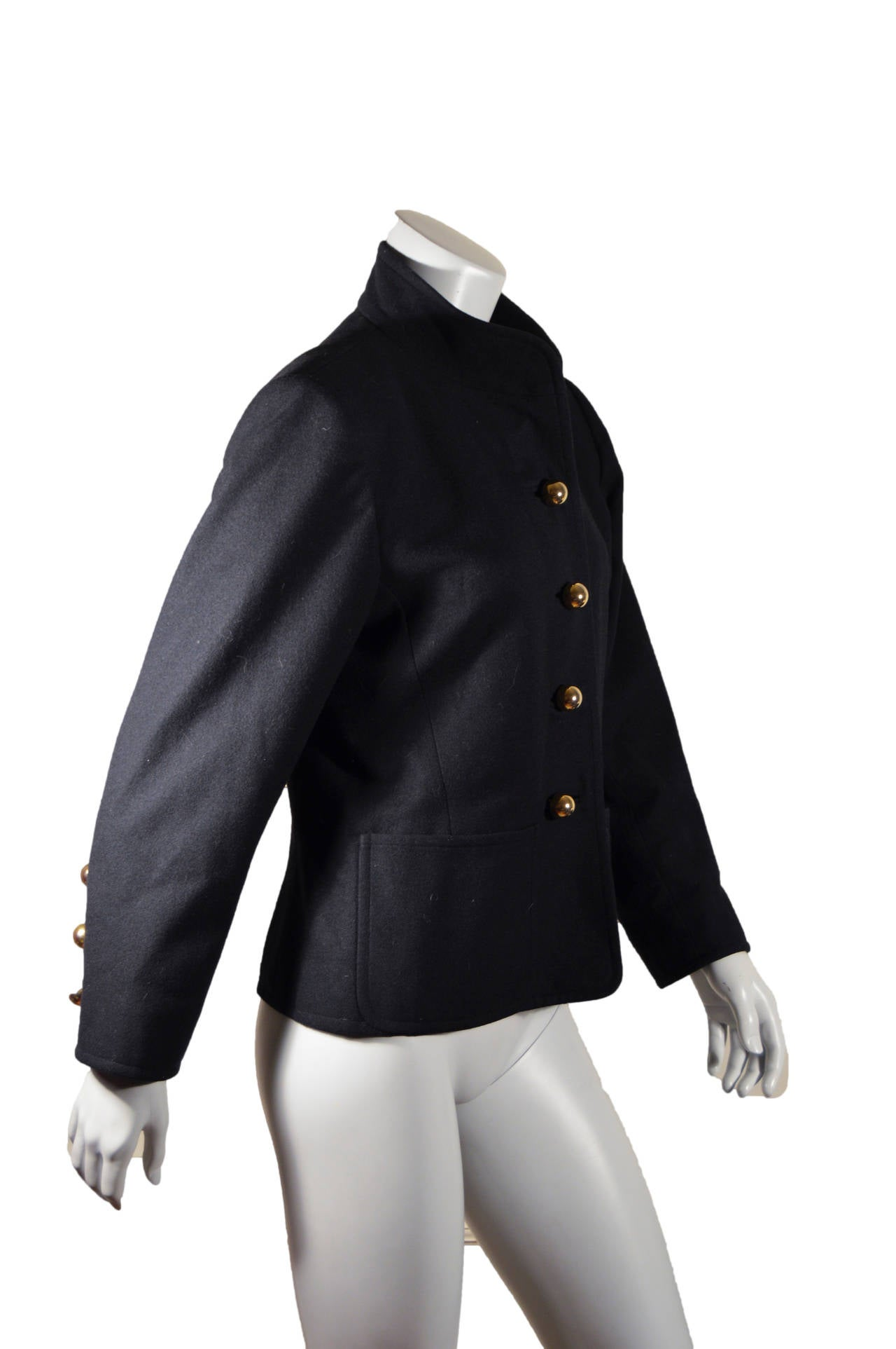 Vintage black YSL Rive Gauche Coat. The stand up collar and round gold buttons give this coat a military feel. Gold buttons at wrists. Wide front pockets. Lined. Tagged a size 42.