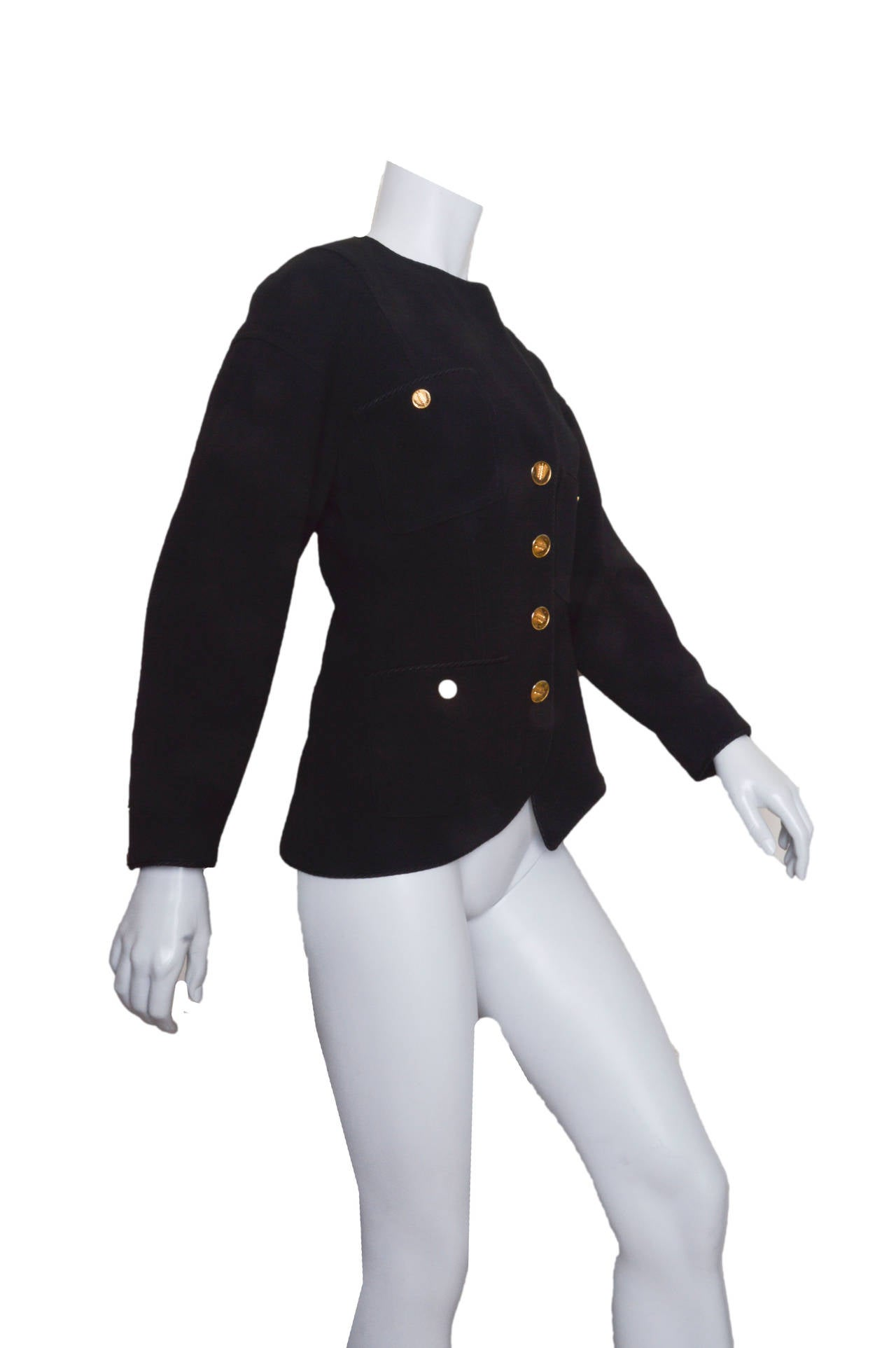 Outstanding Chanel Boutique black jacket. Asymmetrical neckline, pockets and hem. One side of collar folds, one is upright. Fitted through waist. Corded trim throughout. Gold Chanel Cc logo
