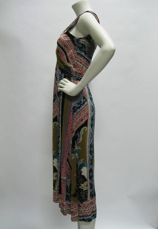 Stretchy Etro printed dress. Slinky lightweight fabric. Twisted empire waist. Deep V neck. Detailed floral motif with bold swatches of color. Long loose skirt. Slightly longer in back. Tagged a size 44. Note: Dress is very stretchy.