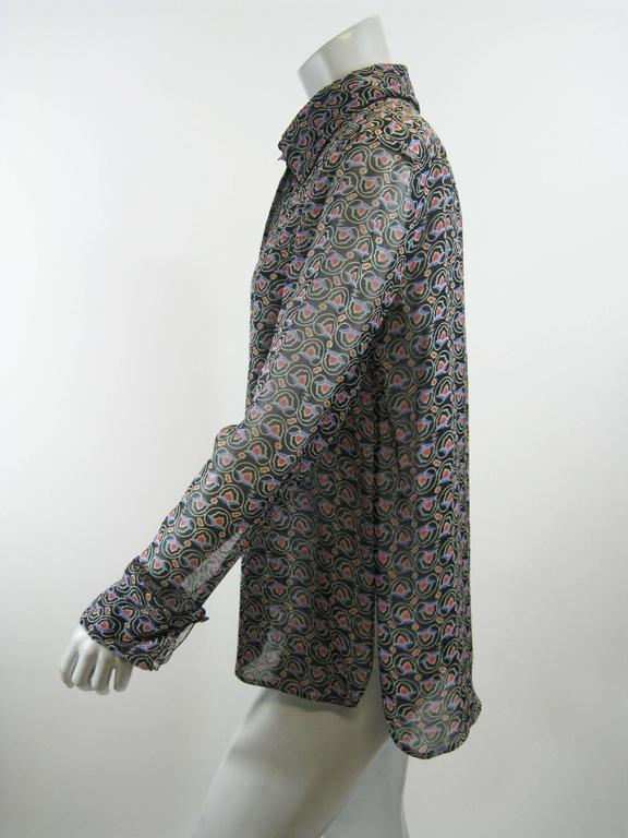 Light and sheer Chanel blouse.