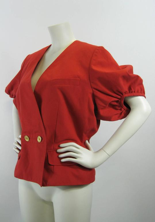 Bright red Yves Saint Laurent jacket.