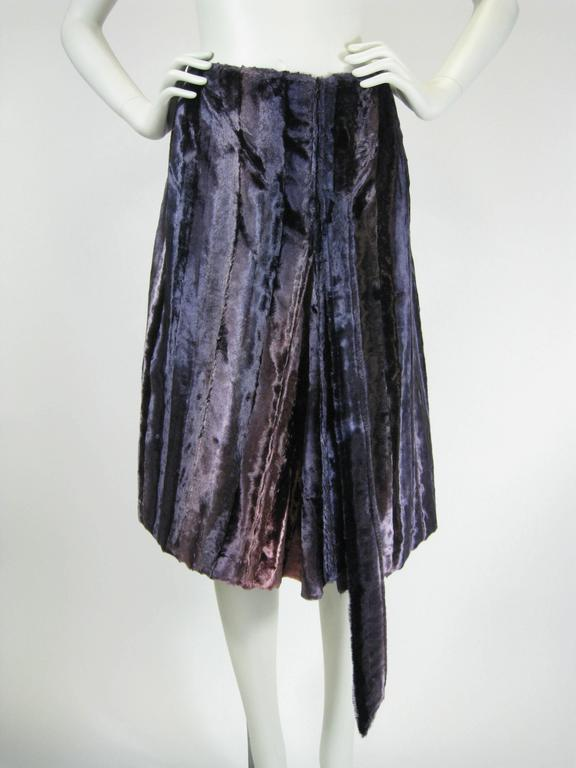 Plush vintage 1990's Jean Paul Gaultier skirt. So much going on this amazing skirt. The pile the of the silk velvet is longer giving it a faux fur look. Iridescent velvet vertical panels in shades of purple and rosey pink. A-line shape. We've
