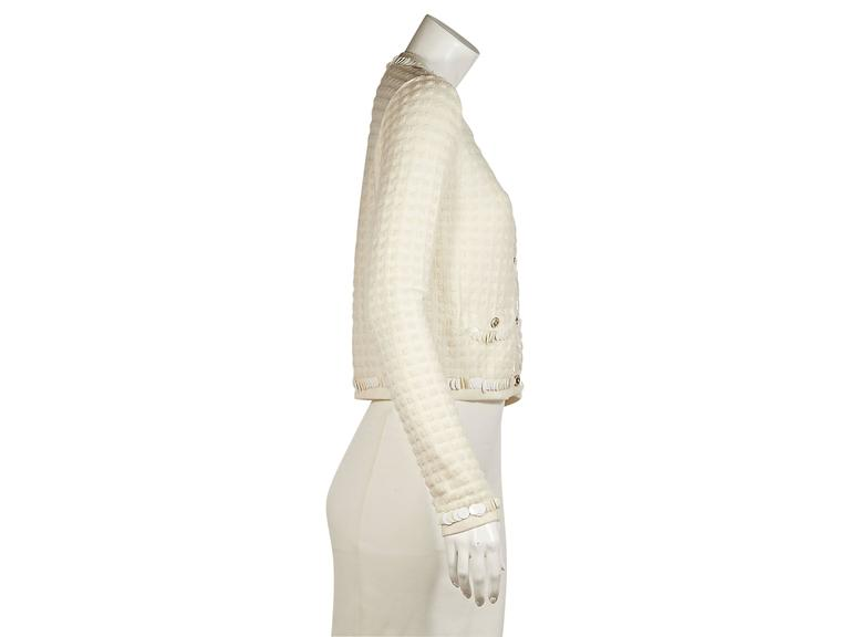 Ivory cashmere and wool blend cardigan by Chanel.  Embellished trim.  Jewelneck.  Long sleeves.  Button-front closure.  Waist button-close pockets.