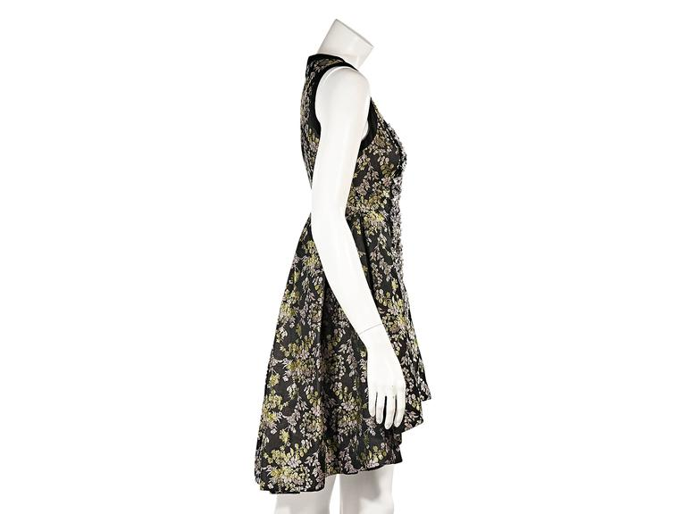 Product details:  Embellished front floral-printed dress by Vera Wang.  Scoopneck.  Sleeveless.  Concealed back zip closure.  Pleated back creates full skirting.  Hi-lo hem. 