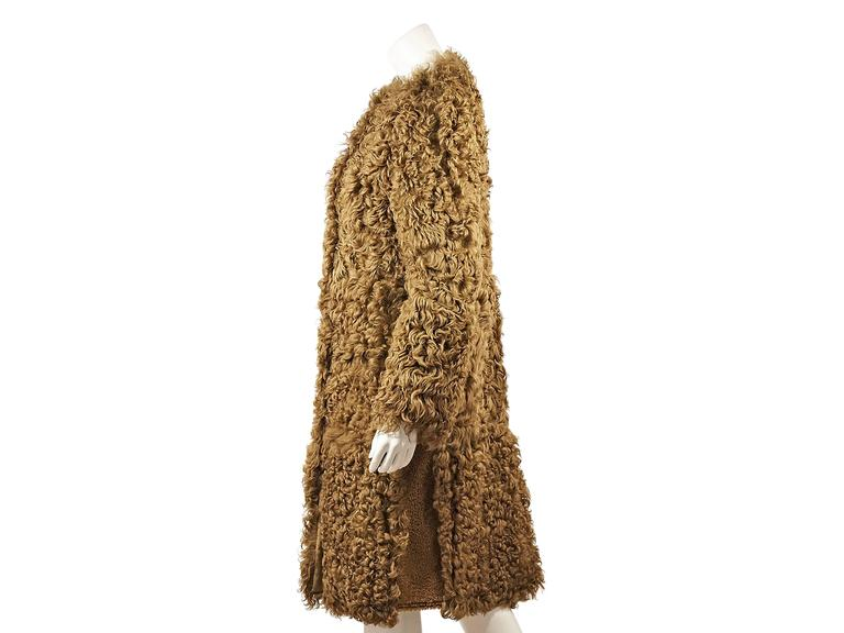 Product details:  Camel shearling coat by Burberry Prorsum.  Crewneck.  Long sleeves.  Concealed front closure.  Back hem vent. Condition: Excellent.