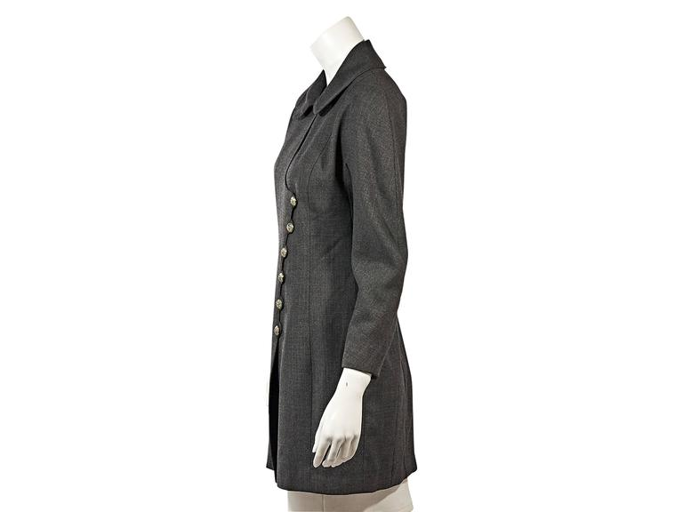 Product details: Vintage grey jacket by Chanel. Peter Pan collar. Bracelet-length sleeves. Asymmetrical button front.  Condition: Very good.
