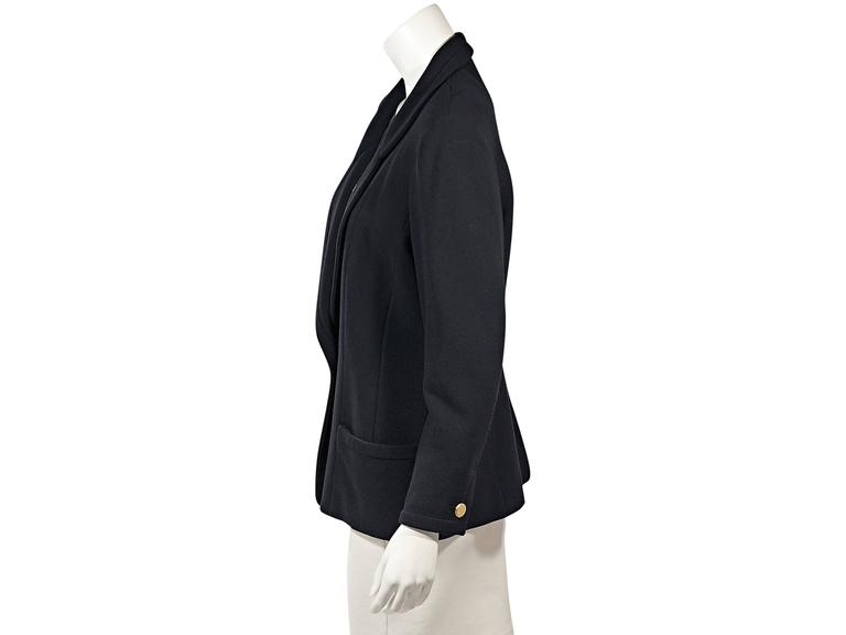 Product details: Vintage navy blazer by Chanel. Rounded notched lapel. Long sleeves. Button cuffs. Single-button closure. Front patch pockets.  Condition: Very good.