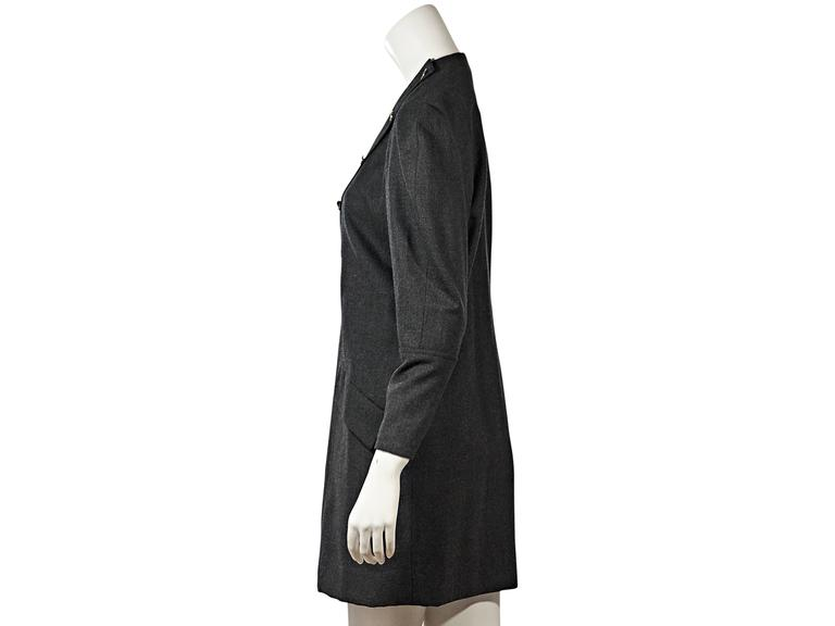 Product details: Vintage grey dress by Chanel. Crewneck. Long dolman sleeves. Asymmetrical button-front closure. Waist flap pockets.  Condition: Very good