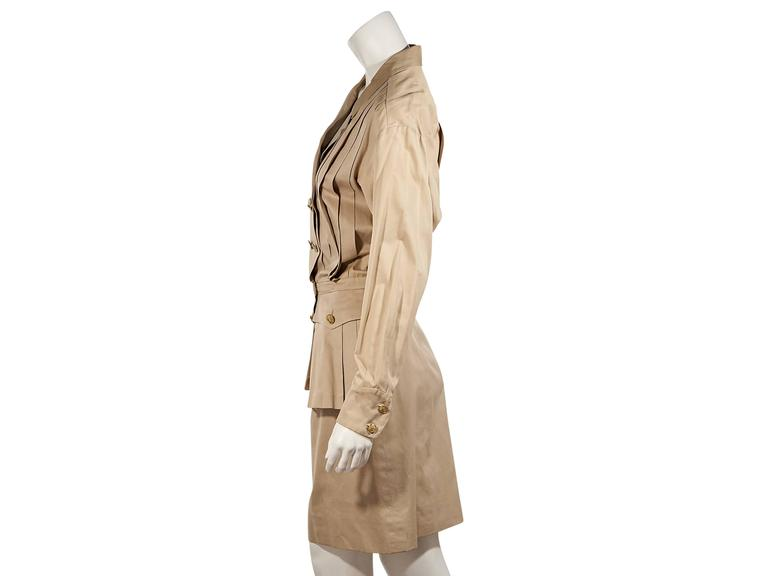 Product details:  Vintage tan pleated dress by Chanel.  Notched lapel.  Long sleeves.  Double button cuffs.  Double-breasted button front.  Banded waist.  Button-flap waist pockets.   Condition: Excellent.  Est. Retail $ 2,348.00