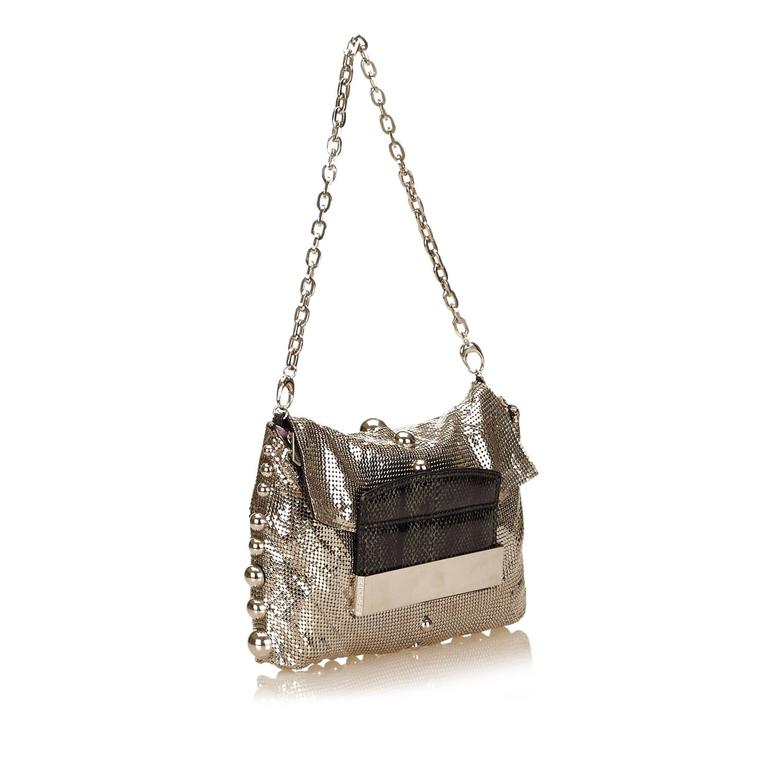 Product details:  Goldtone metal mesh shoulder bag by Jimmy Choo.  Accented with goldtone balls.  Detachable chain shoulder strap.  Python stud-lock closure.  Zip closure under front flap. Lined interior with inner zip pocket.    Condition: