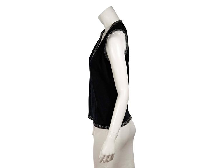Product details:  Black knit sweater shell by Chanel.  Features contrast trim.  U-neck.  Sleeveless.  Pullover style.  Label size FR 44.   Condition: Excellent.  Est. Retail $ 748.00
