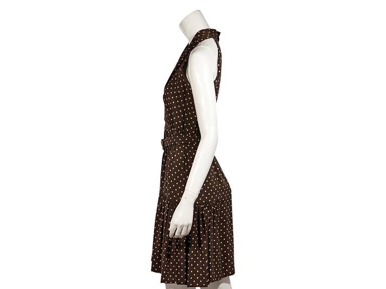 Product details:  Brown vintage polka dot dress by Chanel.  V-neck.  Sleeveless.  Adjustable belted waist.  Concealed back zip closure with double buttons.  Back slit.   Condition: Excellent.  Est. Retail $ 1,498.00