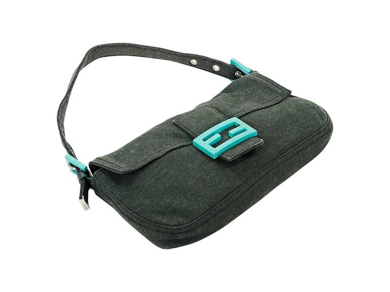 Product details: Green cotton baguette shoulder bag by Fendi. Single adjustable shoulder strap. Front flap. Lined interior with inner zip pocket. Neon teal accents. 10