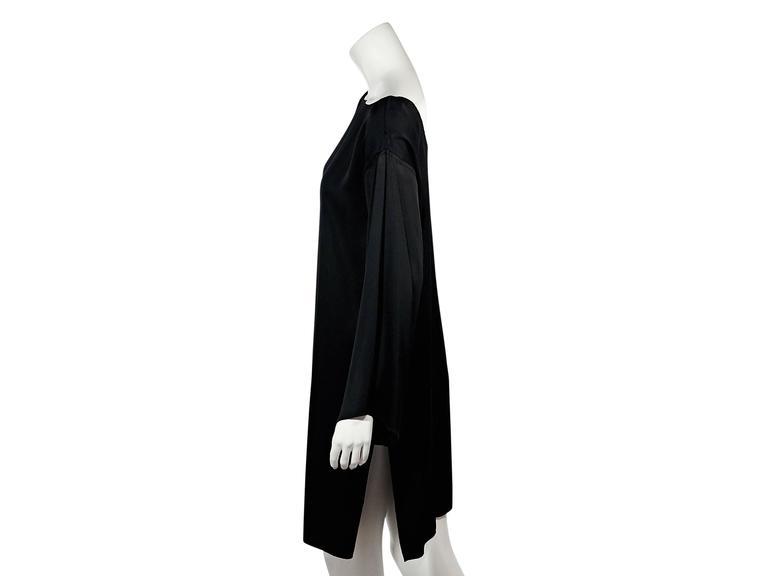 Product details: Black shift dress by Ann Demeulemeester. Boatneck. Long sleeves. Scoopback. Side hem slit. Label size IT 36. Condition: Very good.  Est. Retail $ 748.00