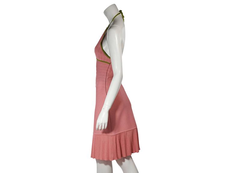 Product details: Pink and green bandage dress by Herve Leger. Self-tie halterneck. Sleeveless. Concealed side zip closure. Ribbed skirt hem.  Condition: Very good. Est. Retail $ 820.00