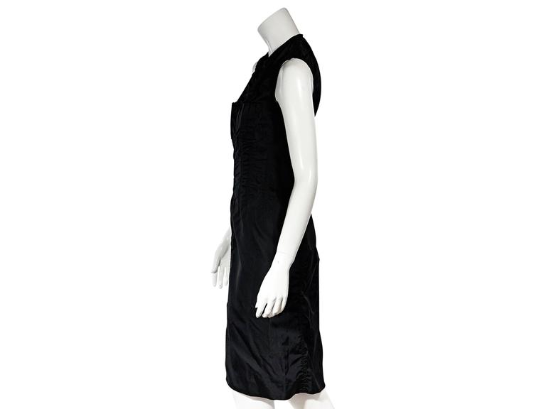Product details: Black silk sheath dress by Yves Saint Laurent. Crewneck. Sleeveless. Concealed hook front closure. Front hem slit. Label size FR 38.  Condition: Very good.  Est. Retail $ 580.00