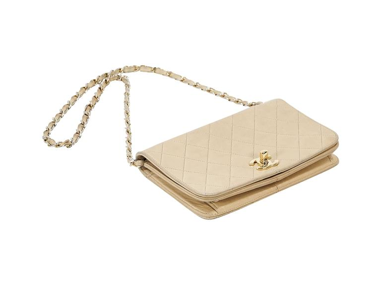 """Product details: Tan quilted leather vintage crossbody bag by Chanel. Chain and leather crossbody strap. Front flap with twist-lock logo closure. Lined interior with inner slide pocket. Goldtone hardware. 8.5""""L x 5.5""""H x 3""""D. 15.5"""" strap"""