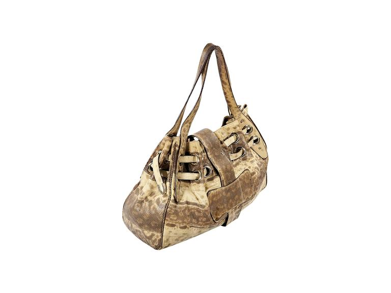 "Product details: Beige snakeskin Ramono shoulder bag by Jimmy Choo. Dual shoulder straps. Top strap with flip-lock closure. Lined interior with inner zip and slide pockets. Goldtone hardware. 20""L x 15""H x 7.5""D. 12"" strap drop."