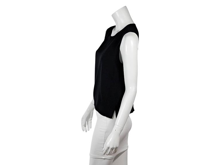 Product details:  Vintage black semi-sheer tank top by Chanel.  Jewleneck.  Sleeveless.  Button back closure.  Tulip hem.   Condition: Pre-owned. Very good.  Est. Retail $ 1,198.00