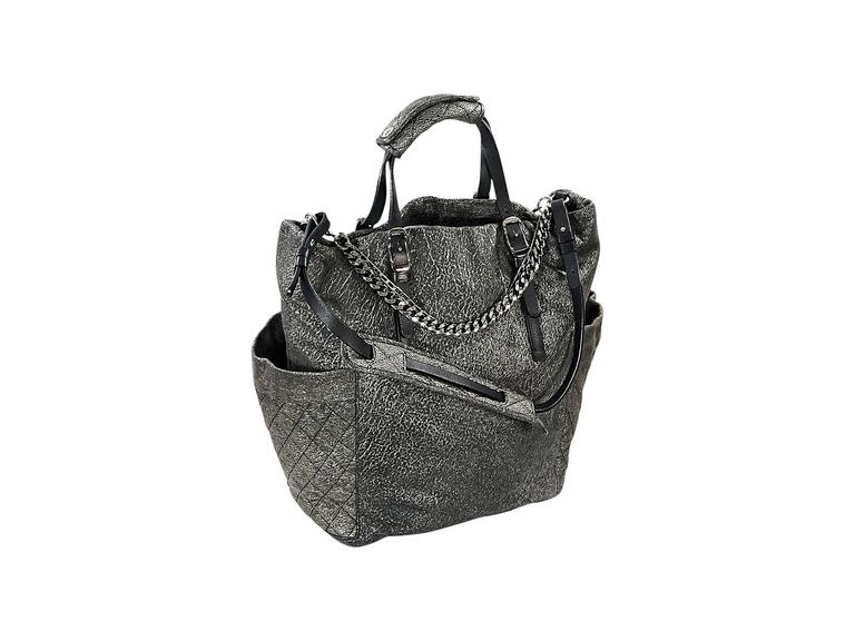 Product details:  Matte silver leather satchel by Jimmy Choo.  Accented with chains.  Top carry handles.  Single shoulder strap.  Side exterior slide quilted pockets.  Lined interior with inner zip and slide pockets.  Silvertone hardware.  15
