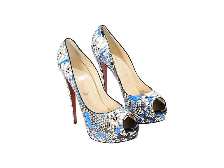 Product details: Multicolor python Lady Graffiti pumps by Christian Louboutin. Peep toe. Towering stiletto and platform design. Iconic red sole. Slip-on style.  Condition: Pre-owned. Very good.  Est. Retail $ 1,575.00