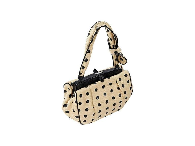 "Product details:  Tan and black polka-dot raffia shoulder bag by Alaia.  Trimmed with black lizard.  Single shoulder strap.  Top push-lock closure.  Lined interior with inner flap pocket.  Silvertone hardware.  12""L x 7""H x 4""D."