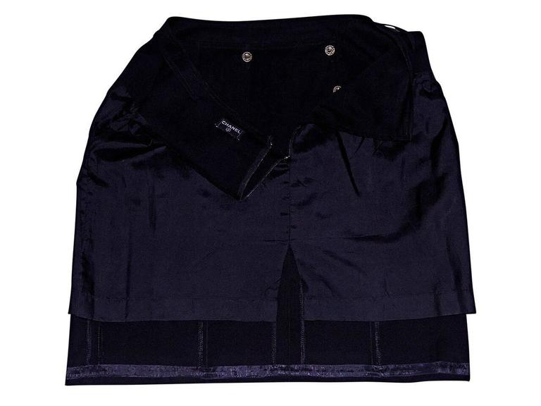 Product details:  Vintage black pleated sailor skirt by Chanel.  Button-front details.  Concealed back zip closure.  Goldtone hardware.   Condition: Pre-owned. Very good. Est. Retail $ 1,198.00