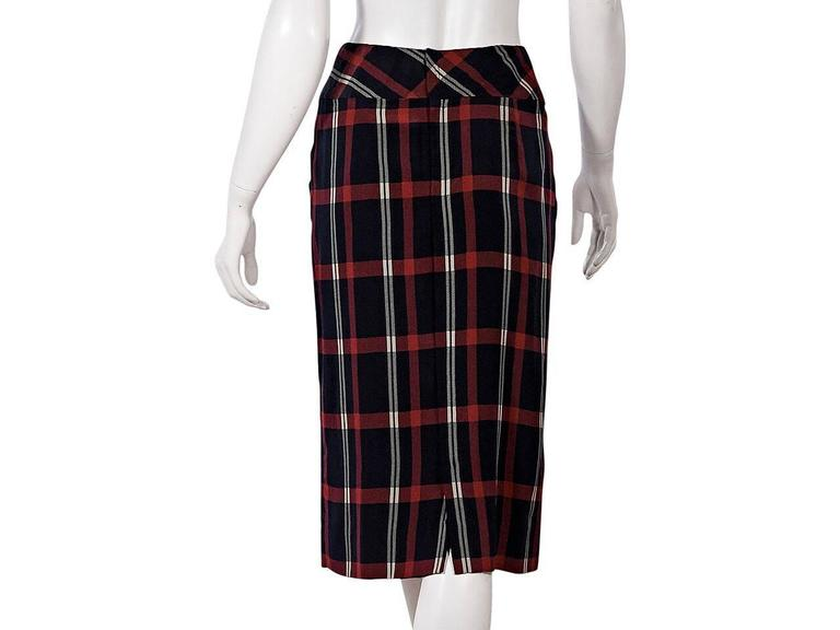 Product details:  Vintage navy blue, red and white plaid pencil skirt by Chanel.  Banded waist.  Concealed back zip closure.  Back center hem vent.   Condition: Pre-owned. Very good. Est. Retail $ 950.00