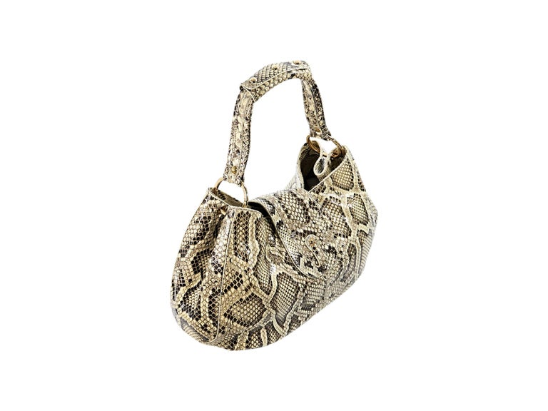 Product details:  Beige python hobo bag by Tod's.  Single shoulder strap.  Top strap with hook closure.  Lined interior with inner center zip compartment and slide and zip pockets.  Front flap pocket with magnetic snap closure.  Goldtone hardware.