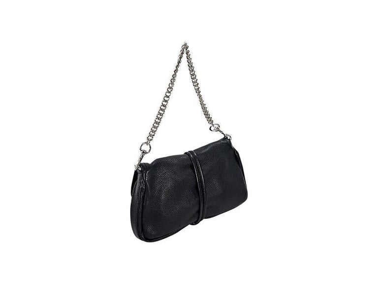 Product details:  Black leather Marrakech shoulder bag by Gucci.  Detachable chain shoulder strap.  Front flap accented with tassel details.  Lined interior with inner slide pocket.  Silvertone hardware.  12