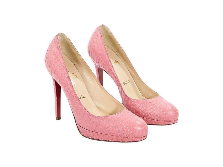 Product details: Pink embossed leather platform pumps by Christian Louboutin.  Round toe.  Iconic red sole.  Slip-on style.  Condition: Pre-owned. Very good. Est. Retail $ 995.00