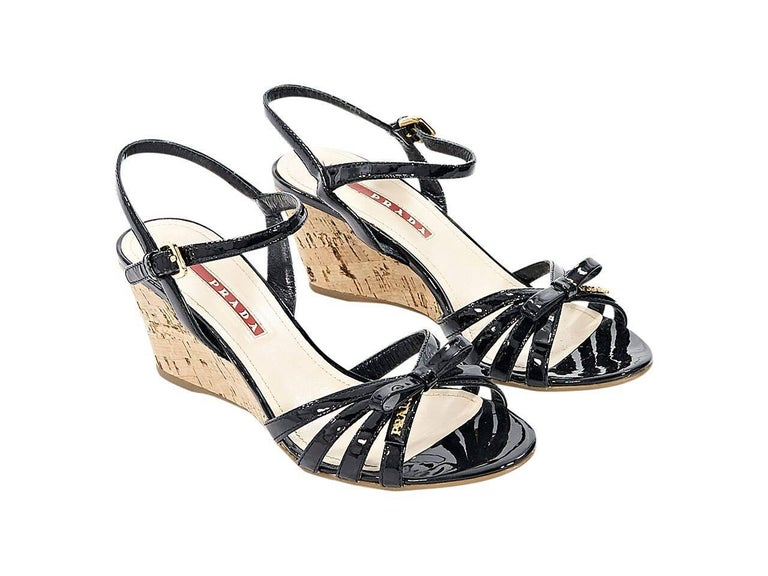 ee791097a6 Product details: Black patent leather wedge sandals by Prada Sport.  Adjustable ankle strap.