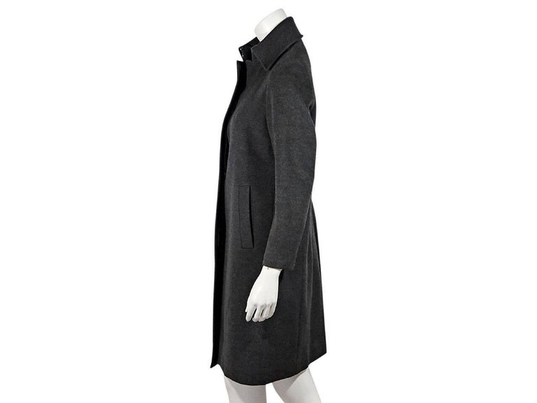 Product details:  Grey wool coat by Burberry London.  Spread collar.  Long sleeves.  Concealed front closure.  Waist slide pockets.  Back center hem vent.   Condition: Pre-owned. Very good. Est. Retail $ 1,485.00