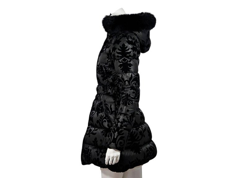 Product details:  Black puffer jacket by Dawn Levy.  Features velvet filigree detail.  Fur-lined hood.  Long sleeves.  Zip-front closure.  Elasticized belt waist.   Condition: Pre-owned. Very good. Est. Retail $ 1,095.00