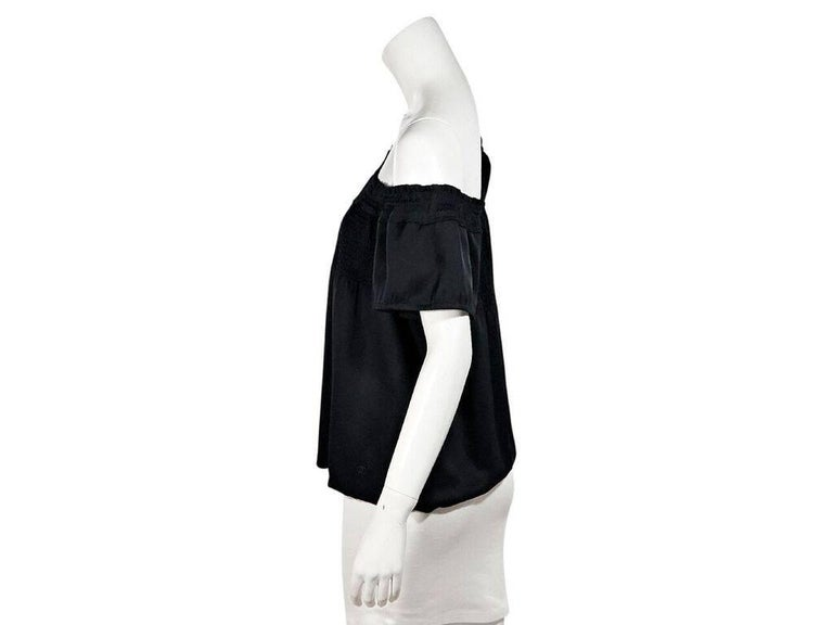 Product details:  Black off-the-shoulder top by Chanel.  Smocked topline.  Short sleeves.  Pullover style.  Condition: Pre-owned. Very good. Est. Retail $ 798.00