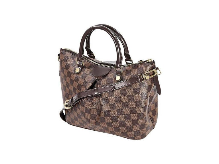 Product details:  Brown damier ebene Siena PM satchel by Louis Vuitton.  Dual carry handles.  Detachable, adjustable crossbody strap.  Top zip closure.  Lined interior with inner slide pockets.  Goldtone hardware.  12
