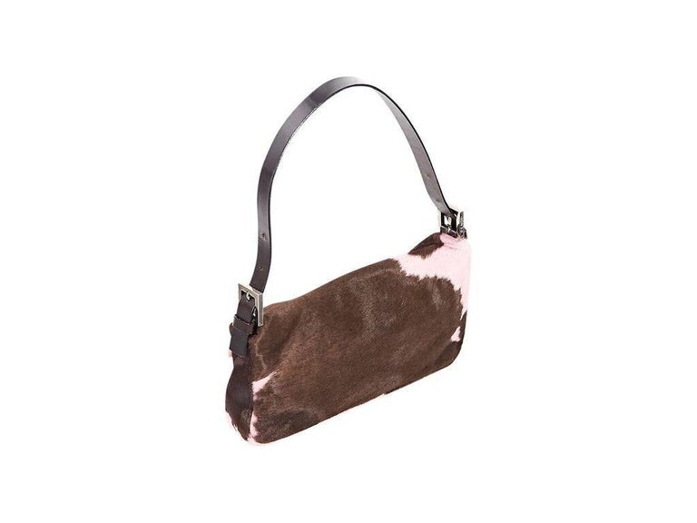 """Product details:  Brown and pink cow-printed pony hair baguette bag by Fendi.  Adjustable single shoulder strap.  Front flap.  Lined interior with inner zip pocket.  Silvertone hardware.  10""""L x 6""""H x 2.5""""D.  7.5"""" strap"""